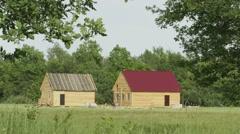 NIZHNY NOVGOROD, RUSSIA - CIRCA JUN 2014: The rural houses construction proce Stock Footage