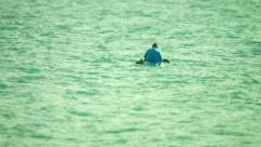 PHUKET, THAILAND - CIRCA OCT 2014: A local man fishes in the sea on a kayak - stock footage