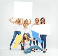 Attractive and cheerful women promoting something - stock photo