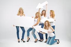 Alluring women promoting the sale - stock photo