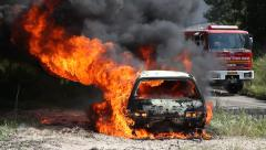 Two cars explode and burn after rocket attack. Stock Footage