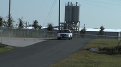 Cop Car Going By Country Road - stock footage