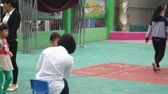 Children enter kindergarten, doctors do a simple physical examination Stock Footage