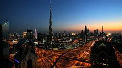Dubai Burj Kalifa Sheikh Zayed Road illuminated sunset UAE - stock footage