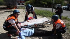 Paramedics treat rocket attack casualties from burning cars, simulation drill Stock Footage
