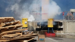 Hazardous corrosive toxic materials leak from barrels after rocket attack Stock Footage