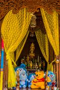 Funny altar toys offerings bangkok Thailand Stock Photos