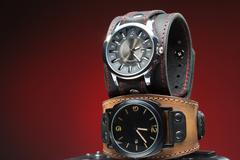 Two men's watches with wide leather bracelet Stock Photos