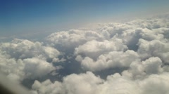 Time Lapse Clouds seen from airplane window Stock Footage