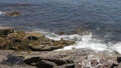 Ocean waves crashing into rocks Stock Footage