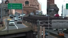 Traffic exiting the 59th street bridge into Manhattan Stock Footage