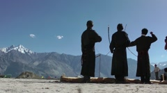 Men at festival shoot  at target,Sumur,Ladakh,India Stock Footage
