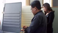 Hispanic man and woman voting Arkistovideo