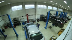 Big car service - auto shop filmed using fish-eye lense Stock Footage