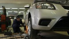 Auto mechanic repair car cut metall with sparks Stock Footage
