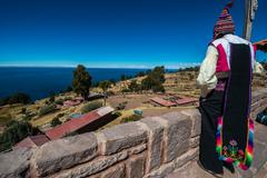 man looking away in the peruvian Andes at Puno Peru - stock photo