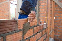 Worker building masonry house wal - stock photo