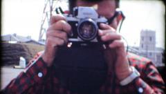 1965 - man with 35mm camera walks toward camera - vintage film home movie Stock Footage