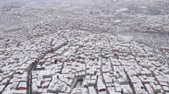 Aerial view of Istanbul under snow, snow buried roofs Stock Footage