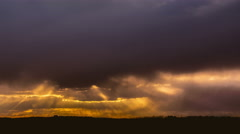 Picturesque sunset by thunderstorm clouds, panoramic camera motion capture - stock footage