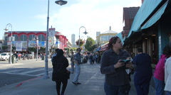 Jefferson Street with tourists in San Francisco Stock Footage