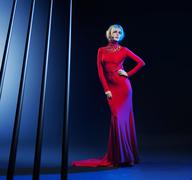 Attractive blond woman wearing evening gown - stock photo