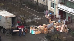 Workers unload items from the van. 4K. Stock Footage