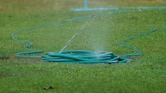Water hose rupture spraying water Stock Footage