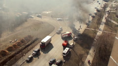 Extinguishing of the burning truck on the road by firefighters. Stock Footage