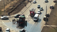 Extinguishing of the burning truck on the road by firefighters. - stock footage