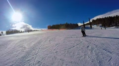 Snowboarder comes to a stop Stock Footage