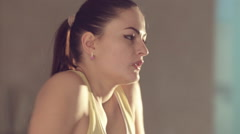 Girl in good physical shape in sportswear doing a workout in the gym Stock Footage