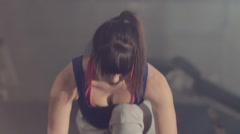Close-up of a girl in good physical shape doing stretching in the fitness room - stock footage