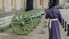 Stock Video Footage of Two guards marching on the three cannons