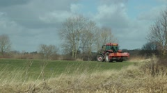 Farming Agriculture red tractor rural scene Stock Footage