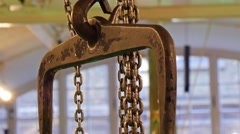 A bronze colored chain carrying heavy metal Stock Footage