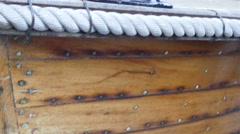 The wooden fishermans boat with lots of nails seen Stock Footage