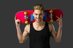 Stock Photo of Young man with a skateboard