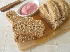 Whole grain bread with vegetable spread from beetroot and horseradish Stock Photos