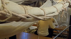 White cloths and ropes hanging on the room - stock footage