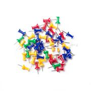 Colorful push pins on white background. Stock Photos