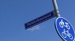 Bicycle path name plate Polderbaanpad - low angle - plane spotting location Stock Footage