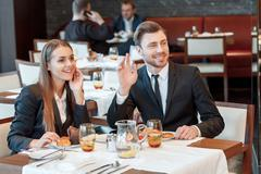 Greeting acquaintances during the business lunch Stock Photos