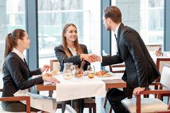 Businessman greets the partners - stock photo