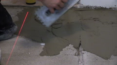 Handyman trowel spread adhesive for ceramic tile stick on floor Stock Footage