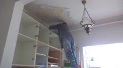 Handyman preparing paint Stock Footage