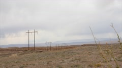 Large telephone poles running through a desert in Utah Stock Footage