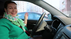 Young adult cheerful woman driver fastening the belt sitting inside car Stock Footage