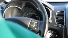 Human driving car, dashboard and wheel with speedometer - stock footage