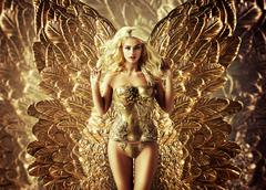 Stock Photo of Blond tempting woman with the golden wings